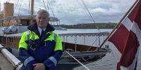 Brian Archibald beside Danish Royal Yacht