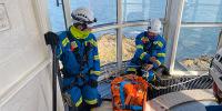 Coastguard at top of tower