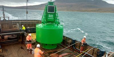 Crew on pole star with green buoy