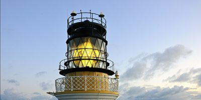 Sumburgh Head lighthouse tower with light shining